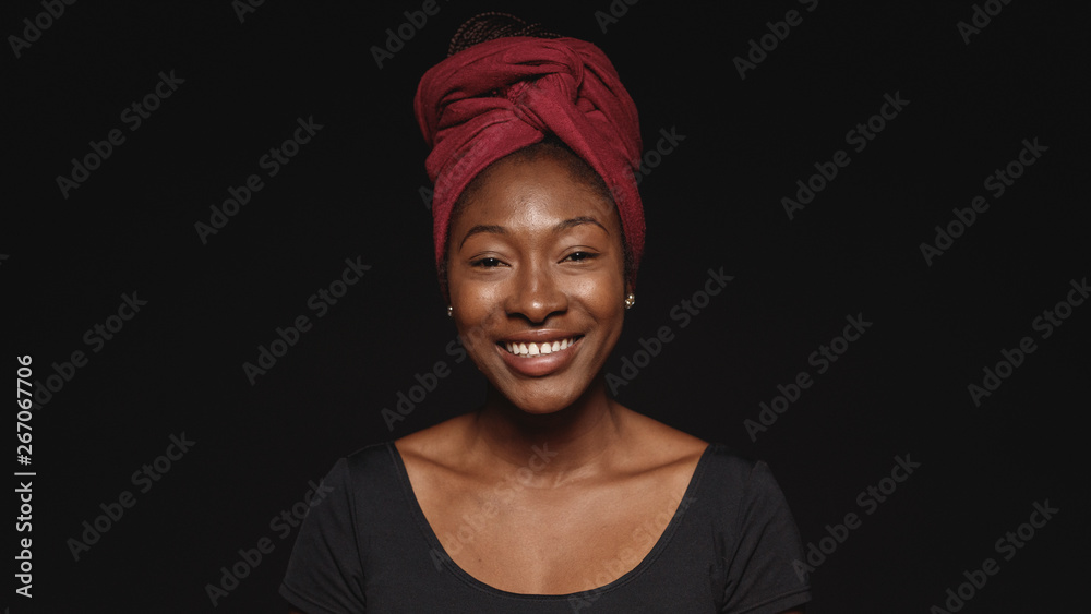 Fototapety, obrazy: Portrait of smiling african woman in a headwrap