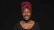 Leinwanddruck Bild - Portrait of smiling african woman in a headwrap