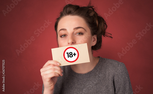 Canvas Prints Textures Young person holding adult content card in hand