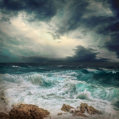 FototapetaStormy sea view near coastline at evening time. Waves, splashed