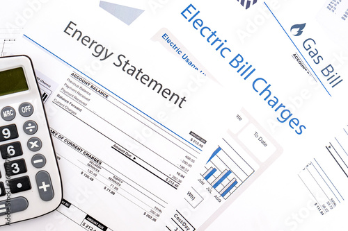 Valokuvatapetti Energy efficiency concept and energy bill papers