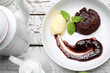 Leinwandbild Motiv Chocolate cake with a scoop of vanilla ice cream and fruit mousse.