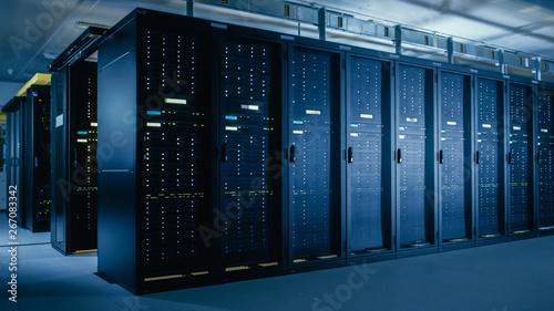 Fotomural Shot of Data Center With Multiple Rows of Fully Operational Server Racks