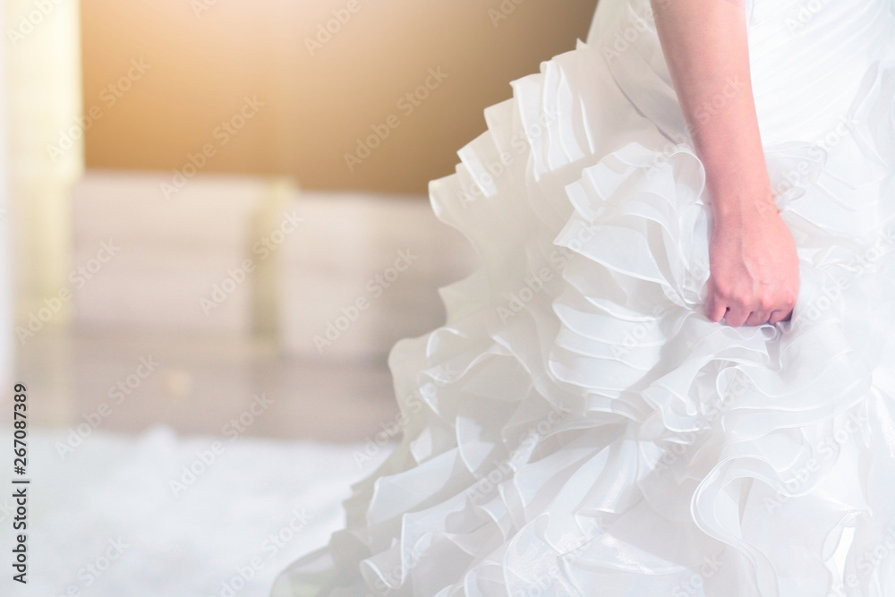 Fototapety, obrazy: Close-up bride holding wedding dress for the wedding ceremony.