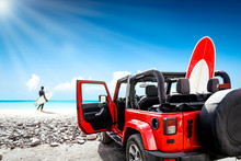 Red Summer Car And Surfer On Beach. Free Space For Your Decoration And Sunny Summer Day.