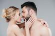 Leinwandbild Motiv beautiful nude young woman hugging bearded shirtless man on grey