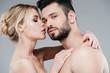 Leinwandbild Motiv beautiful nude young woman hugging handsome shirtless man on grey