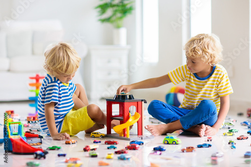 Fotografia Kids play with toy cars. Children playing car toys