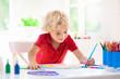Leinwandbild Motiv Kids paint. Child painting. Little boy drawing.