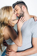 canvas print picture - attractive blonde woman kissing with handsome man on white