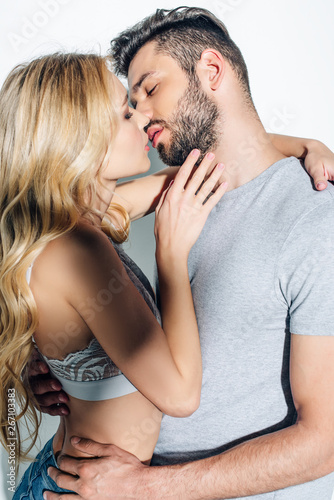 Fényképezés attractive blonde woman kissing with handsome man on white