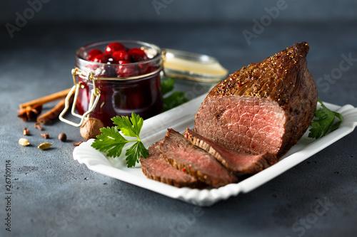 Photo  Homemade roast beef with cherry sauce