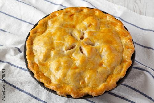 Fotografía Homemade apple pie on cloth, side view.