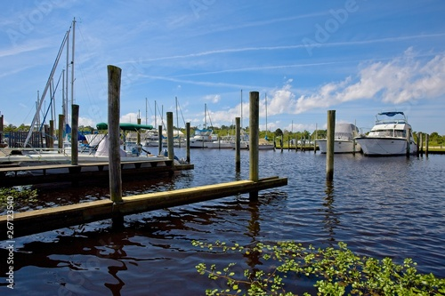 Boats moored in a marina in Bayou Libery in Slidell, Louisiana on a sunny spring Wallpaper Mural