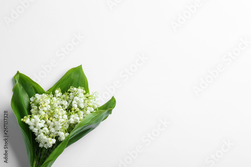 Wall Murals Beautiful lily of the valley bouquet on white background, view from above. Space for text
