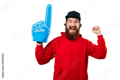 Canvastavla Excited fan, photo of bearded man supporting with big blue fan glove
