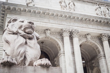 Monumental Entry Of The New York Public Library With The Statue Of The Lion Truncating And Watching Passersby - New York City, NY