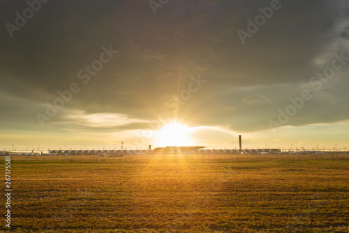 Sunset against the light on the gold lawn at  Airport bangkok thailand Wallpaper Mural