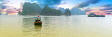 Fishing Boat On Ha Long Bay In The Afternoon. It Is Considered A World Natural Heritage Site In Vietnam
