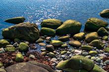 A Rocky Shoreline By The Sea. ...
