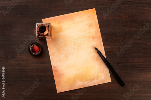 A vintage background with a nib pen on a piece of old paper, with an ink well, s Canvas Print