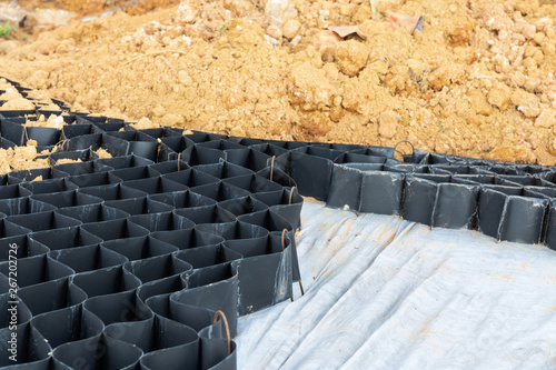 Fotografie, Obraz Slope erosion control grids, sheets and earth on steep slope