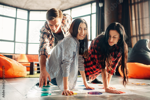 Group of students playing twister game Canvas-taulu