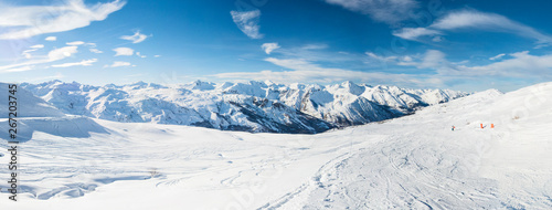 Panoramic view down snow covered valley in alpine mountain range - 267203745