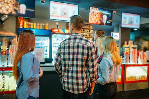 Valokuva  Friends choosing food in cinema bar