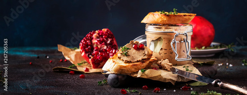 Meat liver pate on toasted bread with fruit seeds and spice herb, brown kitchen Canvas-taulu