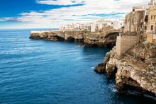 Rocky Coast With The Houses Of Polignano A Mare And The Blue Sea