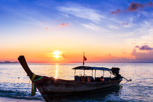 Travel Concept: Traditional Thai Boats At Sunset Beach