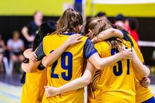 Female Volleyball Players Hudd...