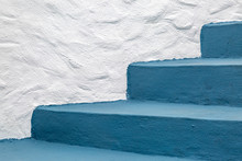 Painted Blue Steps And A White Wall On The Outside Of A Building