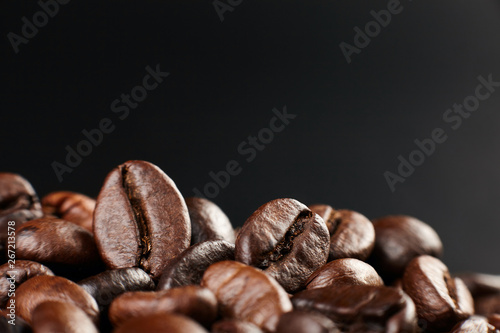 Fototapeta Roasted coffee beans on dark background. Close up obraz na płótnie