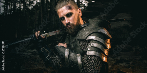 mystery scarface knight in armor with sword and crossbow in the forest Canvas Print