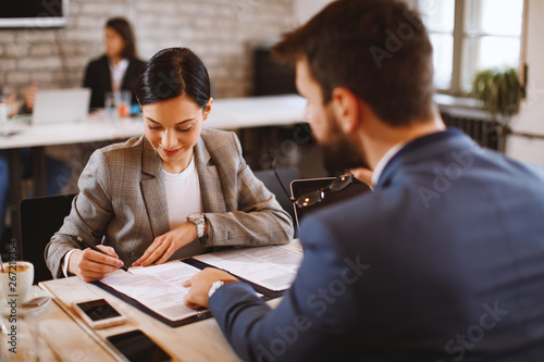 Fototapeta Young woman signs an employment contract obraz