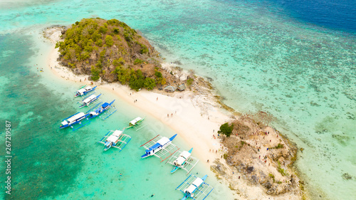 Wall Murals Green coral Philippine islands with white beaches. Boats for tourists near the shore, view from above. Philippines, Palawan
