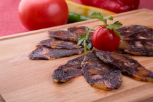 Rustic Raw Smoked Meat Sliced On Chopping Board
