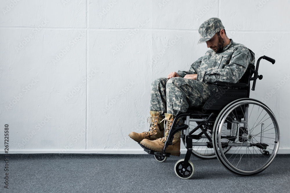 Fototapety, obrazy: depressed disabled military man in uniform sitting in wheelchair with bowed head