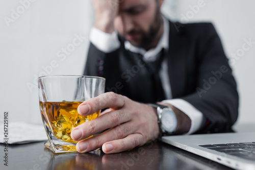 Recess Fitting Alcohol selective focus of depressed businessman holding glass of whiskey