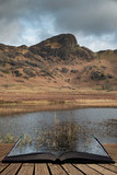 Beautiful vibrant sunrise landscape image of Blea Tarn in UK Lake District  coming out of pages in story book - 267226547