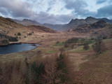 Beautiufl unique drone aerial sunrise landscape image of Blea Tarn and Langdales Range in UK Lake District - 267226764