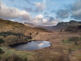 Beautiufl unique drone aerial sunrise landscape image of Blea Tarn and Langdales Range in UK Lake District - 267226971