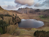 Beautiufl unique drone aerial sunrise landscape image of Blea Tarn and Langdales Range in UK Lake District - 267227363