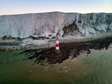 Stunning Aerial drone landscape image of lighthouse and chalk cliffs at sunrise in England - 267227563