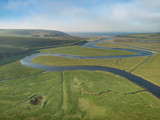 Stunning aerial drone landscape image of meandering river through marshland at sunrise - 267227941