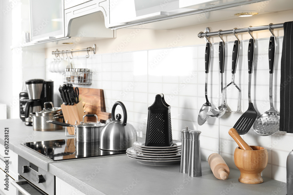 Fototapety, obrazy: Different appliances, clean dishes and utensils on kitchen counter
