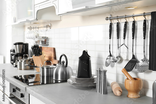 Different appliances, clean dishes and utensils on kitchen counter Canvas Print