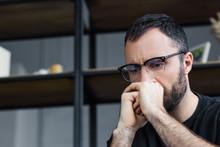 Thoughtful Bearded Man In Glas...